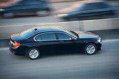 Автомобиль идя на дорогу Стоковые Изображения
