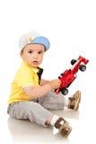 автомобиль мальчика его играя игрушка Стоковые Изображения RF