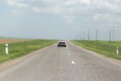 Автомобиль на дороге стоковое фото