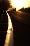 автомобиль освещает заход солнца Стоковое фото RF