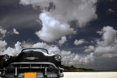 автомобиль пляжа мечтательный Стоковые Изображения