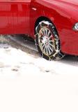 автомобиль приковывает автошину снежка Стоковые Фото