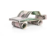 Автомобиль сделанный от доллара на белой предпосылке Стоковое Фото