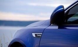 Автомобиль спорта голубой припаркованный на парке Windjammer Стоковое Изображение RF