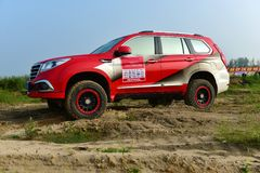 Автомобиль HAVAL H6 SUV в песке Стоковое Фото