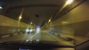 Автомобиль POV управляет на новой славной дороге Движения автомобиля через tonnel к Krasnaya Polyana акции видеоматериалы