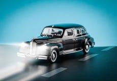 Автомобили игрушки на дороге Стоковое фото RF