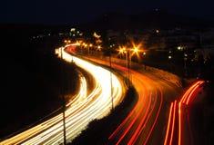 Автомобили на ноче Стоковое Фото