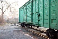 Автомобили на следах поезда Стоковое фото RF