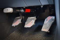 Автомобили педали и приборы анти--похищения стоковые изображения rf