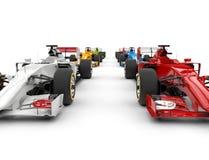 Автомобили Формула-1 - красные и белые в переднем ряде Стоковая Фотография RF