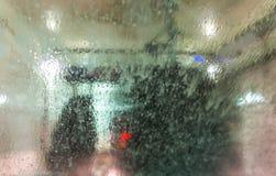 Автомобиль бежать через автоматическую мойку Стоковое фото RF
