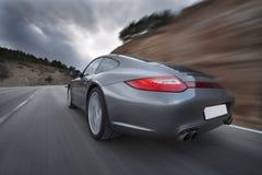 Автомобиль быстро проходя, запачканное движение Стоковое Изображение