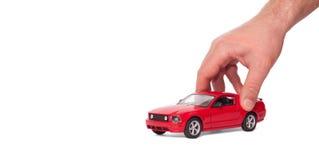 Автомобиль в руке стоковое фото