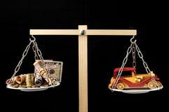 Автомобиль денег и игрушки деревянный Стоковое Фото
