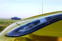 Автомобиль золота фары Стоковое Изображение
