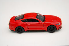 Автомобиль игрушки миниатюрный красный Стоковые Фотографии RF