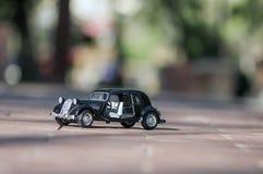 Автомобиль игрушки на дороге Стоковая Фотография