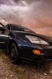 Автомобиль и заход солнца стоковая фотография