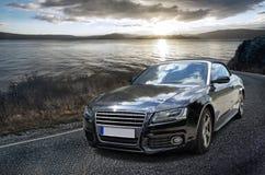 Автомобиль на заходе солнца стоковая фотография rf