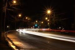 автомобиль освещает ночу Стоковые Фотографии RF