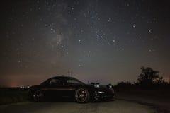 Автомобиль под звездами Стоковая Фотография RF