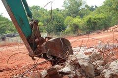 Автомобиль Backhoe в сверлить почвы стоковое изображение rf