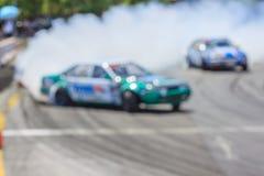 Автомобиль Blurred перемещаясь на следе Стоковые Изображения
