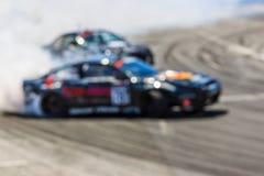 Автомобиль Blurred перемещаясь на следе Стоковые Фото