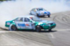 Автомобиль Blurred перемещаясь на следе Стоковое Фото