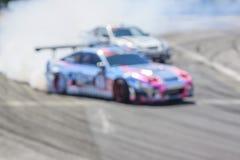 Автомобиль Blurred перемещаясь на следе Стоковое Изображение