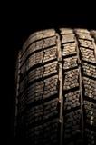 Автошина зимы изолированная на черноте Стоковые Фото