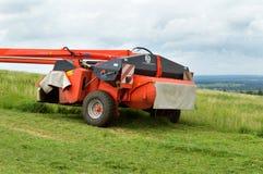 Аграрные косилка и трактор Стоковые Фото