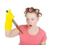 агрессивныйый запятнанный кровью нож домохозяйки Стоковая Фотография