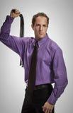 Агрессивный человек с черной плеткой Стоковая Фотография