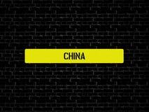 Адвокатура в желтом цвете слово КИТАЙ показано Предпосылка черна с плитками стоковые фото