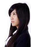 Азиатская бизнес-леди смотрит вверх Стоковые Изображения RF