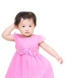Азиатская голова царапины маленькой девочки Стоковые Изображения