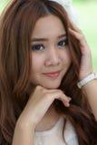 Азиатская девушка в парке Стоковые Изображения RF