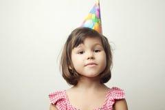 Азиатская девушка в шляпе партии Стоковые Изображения RF