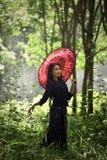Азиатская девушка жизнерадостное Стоковое Фото