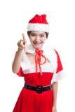 Азиатская девушка Санта Клауса рождества делает представление экрана касания Стоковое Изображение