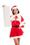 Азиатская девушка Санта Клауса рождества с пустым знаком Стоковая Фотография