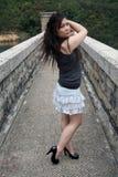 Азиатская девушка стоя один outdoors Стоковые Изображения RF