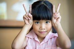 азиатская девушка счастливая немногая усмешка Стоковое Фото