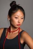Азиатская девушка с красными шариками Стоковые Фото
