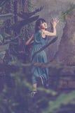 Азиатская женщина бежать прочь стоковая фотография