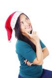 Азиатская женщина нося шлем Санта Стоковая Фотография RF