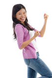 Азиатская женщина празднуя успех стоковое изображение