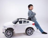 Азиатская игрушка автомобиля мальчика Стоковая Фотография